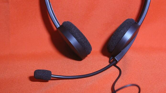 black-headset-on-a-red-table