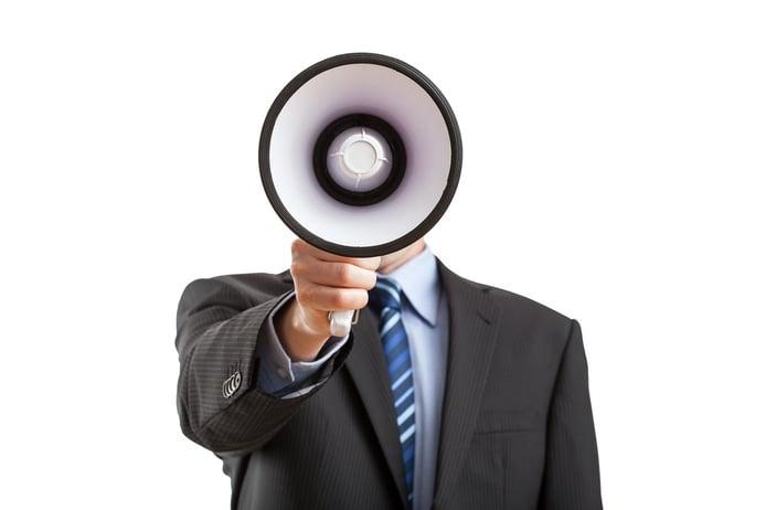 Man with megaphone giving an annoucement.jpeg