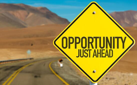 Opportunity Just Ahead sign on desert road.jpeg