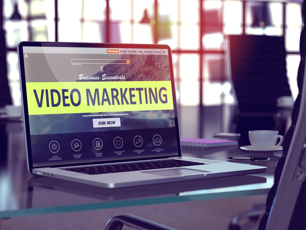 Video Marketing Concept. Closeup Landing Page on Laptop Screen  on background of Comfortable Working Place in Modern Office. Blurred, Toned Image. 3d render..jpeg
