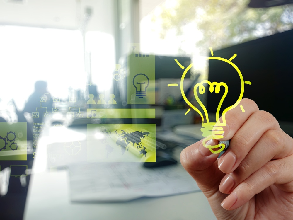 hand drawing creative business strategy with light bulb as concept.jpeg