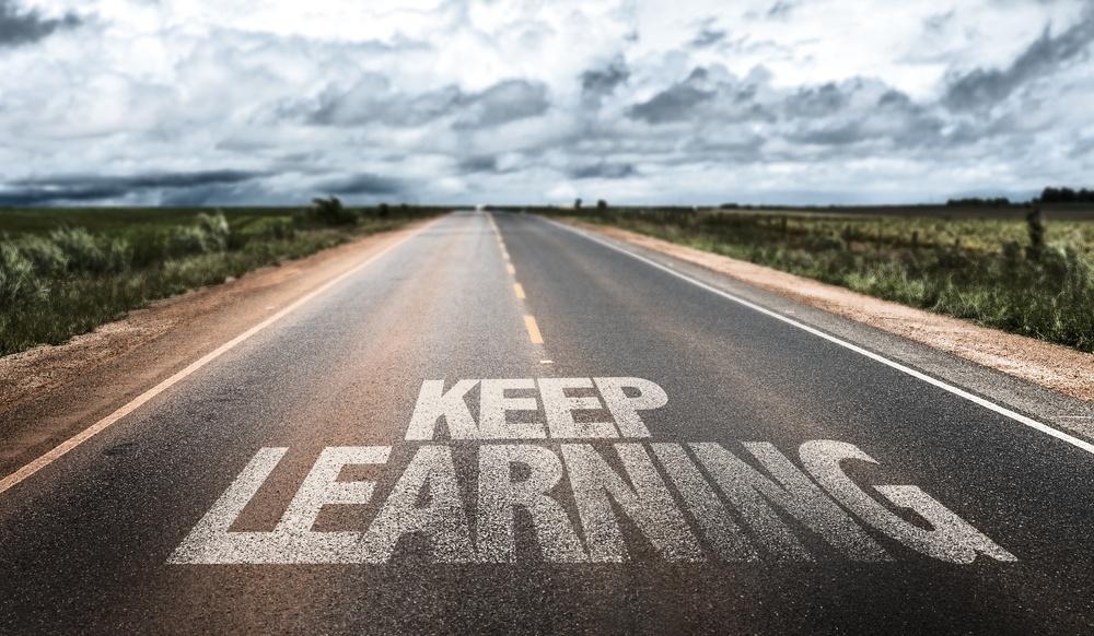 Keep Learning written on rural road.jpeg